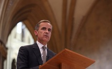 Bank of England holds interest rate but slashes forecast